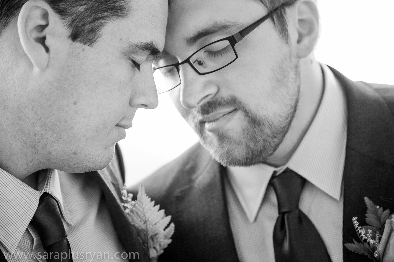 24 gay men wedding portrait resting foreheads closed eyes