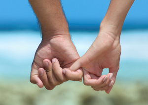 couples-holding-hands-at-beach