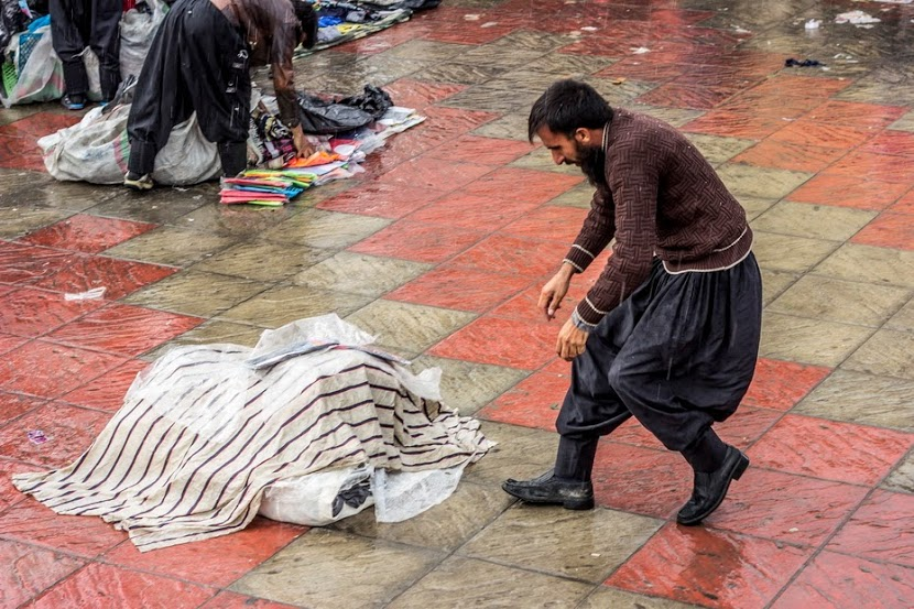 peddler in the rain - Mohammad Roodgoli