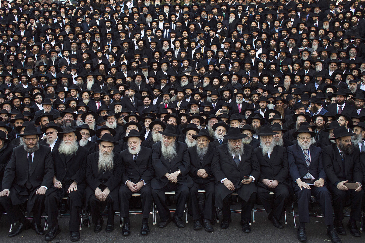 Thousands of Lubavitch rabbis from 86 countries prepare for their group photo to be taken near Chabad-Lubavitch headquarters in the Brooklyn borough of New York, Sunday, Nov. 8, 2015. The group is in New York for the International Conference of Chabad-Lubavitch Emissaries, an annual event aimed at reviving Jewish awareness and practice around the world. (AP Photo/Andres Kudacki)