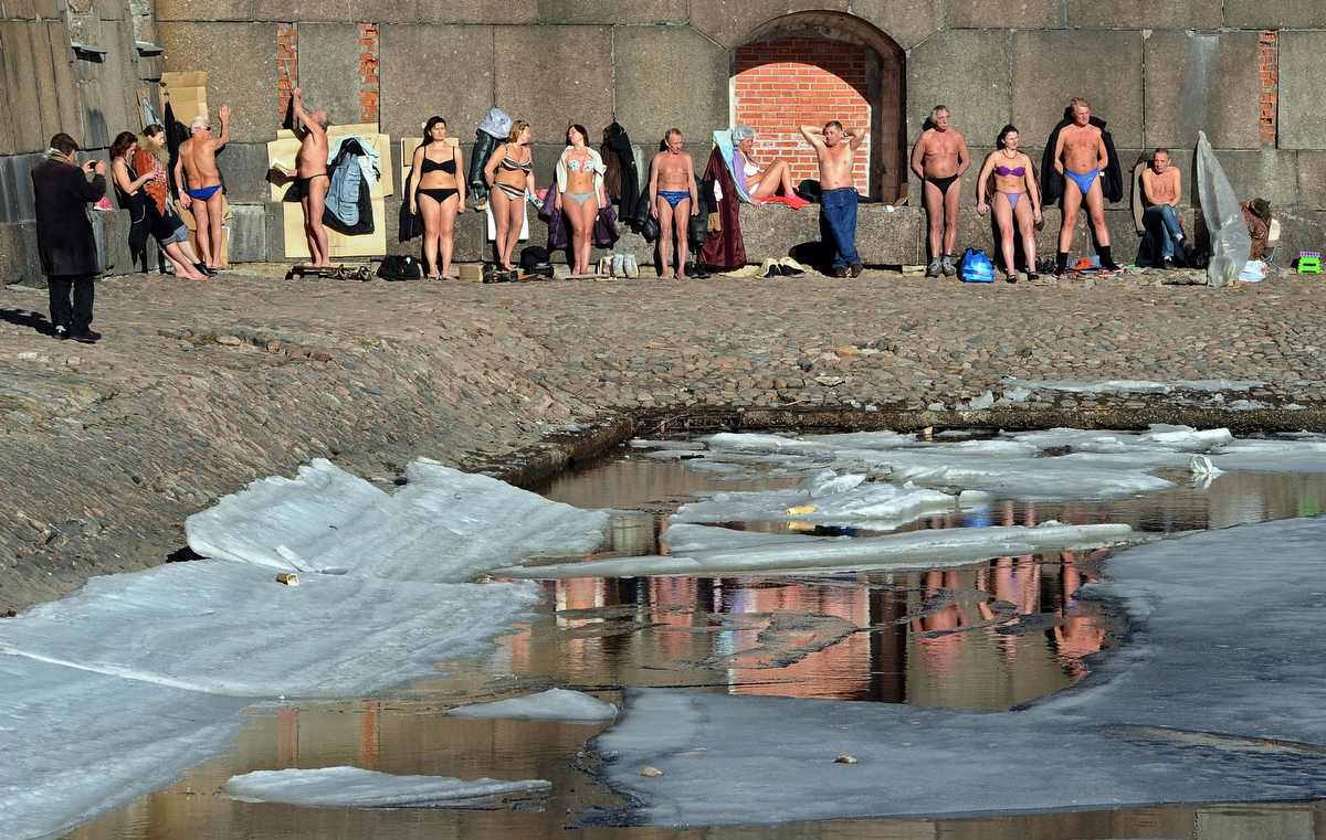People enjoy sunbathing at the wall of the Peter and Paul fortress in Saint Petersburg. (Olga Maltseva/AFP/Getty Images)