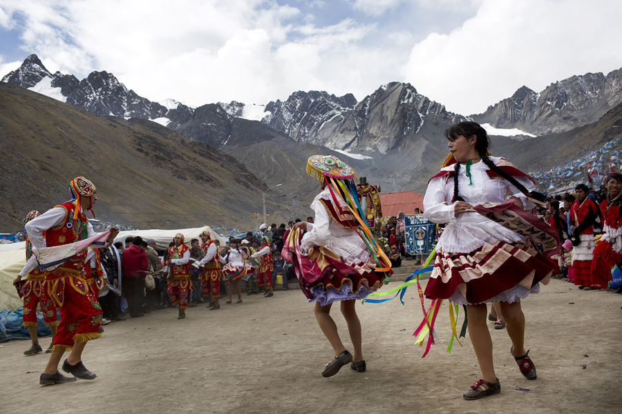 In this May 23, 2016 photo, backdropped by the Qullqip'unqu mountain, dancers perform during the second day of the syncretic festival Qoyllur Rit'i, translated from the Quechua language as Snow Star, in the Sinakara Valley, in Peru's Cusco region. Dance is central to the three-day celebration. (AP Photo/Rodrigo Abd)
