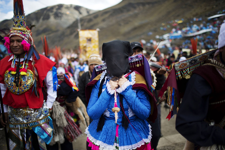 In this May 23, 2016 photo, pilgrims wait for the start of a procession to the Sanctuary of the Lord of the Qoyllur Rit'i, as part of the syncretic festival of the same name, translated from the Quechua language as Snow Star, in the Sinakara Valley, in Peru's Cusco region. Religious processions, dance and music are central to the three-day celebration. (AP Photo/Rodrigo Abd)