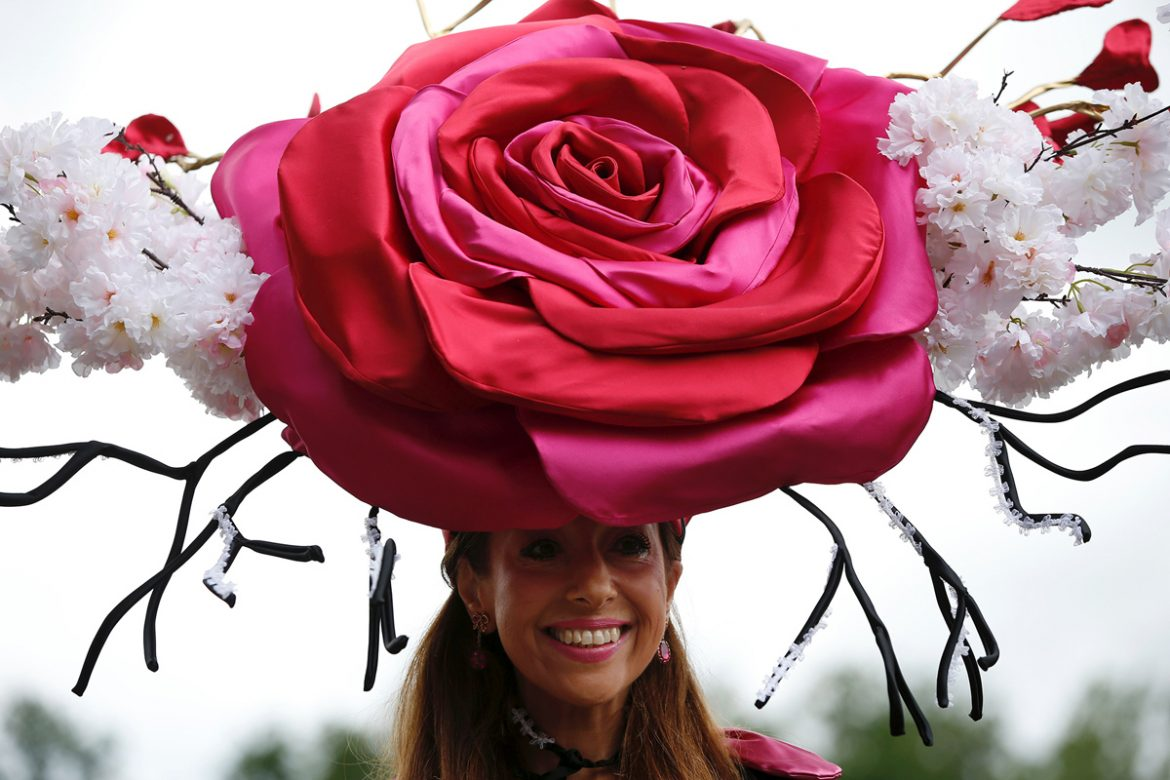 A racegoer poses for a picture during Ladies day at Royal Ascot in Ascot, west of London on June 16, 2016.