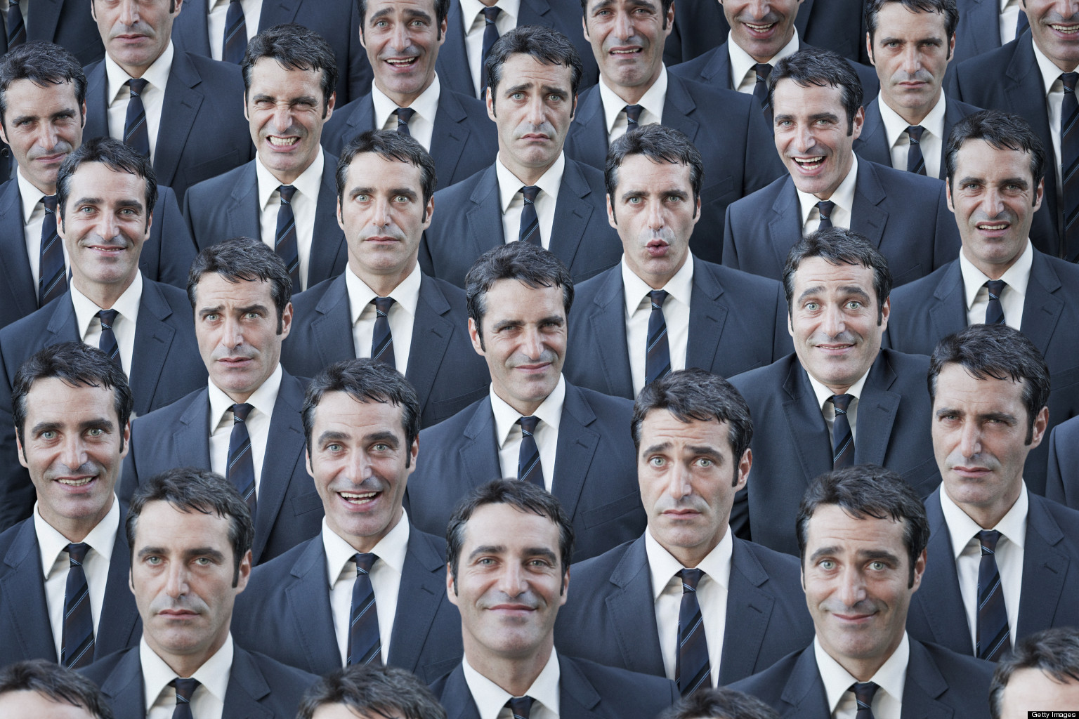 Crowd of businessmen with multiple expressions