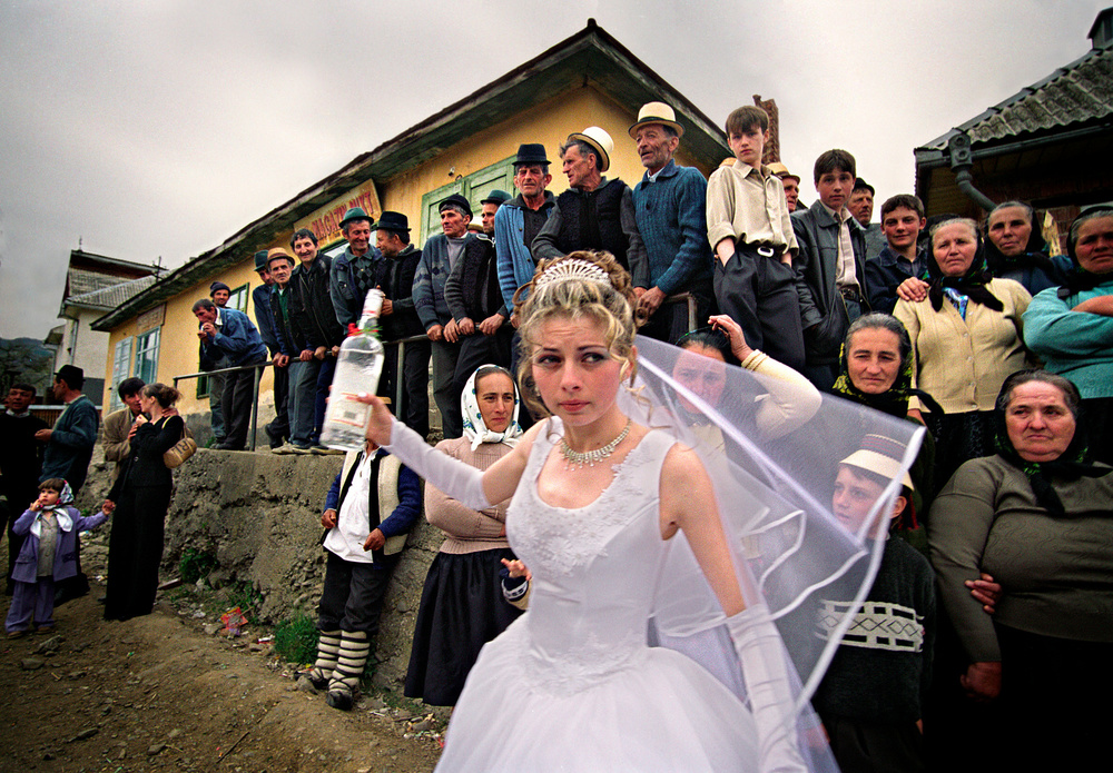 the-vodka-bride-wedding-in-maramures-romania-in-this-very-traditional-county-a-bride-offers-a-shot-of-liquor-to-the-people-the-couple-is-working-in-the-eu-but-they-came-home-for-the-wedding