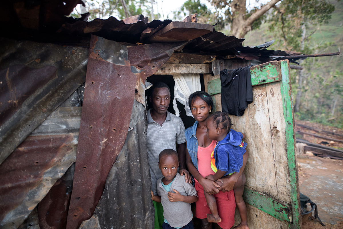 CAMP PERRIN, HAITI - OCTOBER 15: A young family pictured in their provisionally shelter build of old corrugated sheet on October 15, 2016 in Saut-Maturin near Camp Perrin, Haiti. Matthew had heavily devastated the southern half of Haiti on Tuesday last week. According to preliminary information from the authorities, 372 people were killed. Some regions are still cut off from the rest of the country. In some cities 80 per cent of the houses are destroyed or damaged, according to aid organizations. (Photo by Thomas Lohnes/Getty Images)