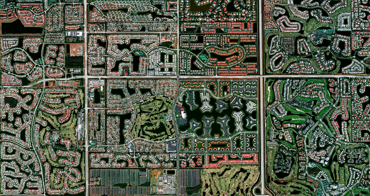 Residential development is seen in Boca Raton, Florida. Because many cities in the state contain master-planned communities, often built on top of waterways in the latter half of the 20th century, there are a number of intricate designs that are visible from this perspective. Boca Raton is home to roughly 91,000 residents. # Benjamin Grant / Daily Overview / Amphoto Books / DigitalGlobe