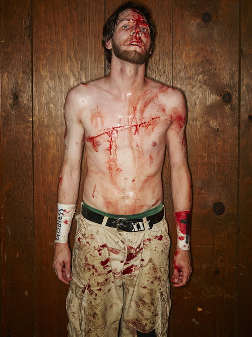 Wrestler Adam Bueller backstage after his match at the 2015 IWA Mid-South Royal Weekend of Death. His chest wound was superglued back together.