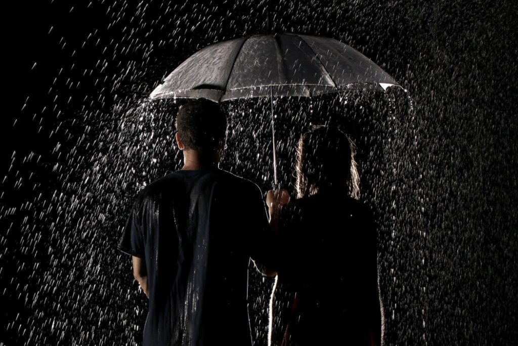 boy-and-girl-holding-umbrella-in-rain-t2